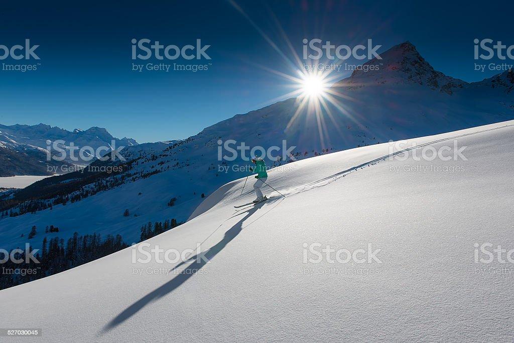 girl in off-piste skiing stock photo