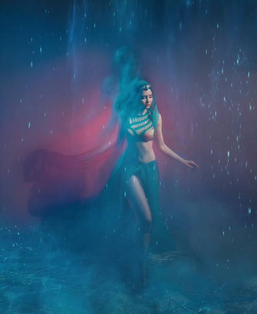 A girl in oriental attire, Queen of the storm. Princess Jasmine. The background is a twist and a strong wind. Studio shooting with mixed light. Artistic Photography stock photo