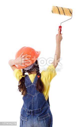 istock Girl in overall with paintroller 177414279