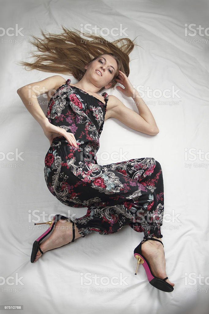 Girl in overalls with flowers pattern royalty-free stock photo