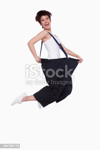 istock Girl in oversized pants jumping 184765176