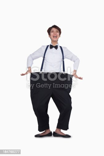 istock Girl in oversized pants 184765277