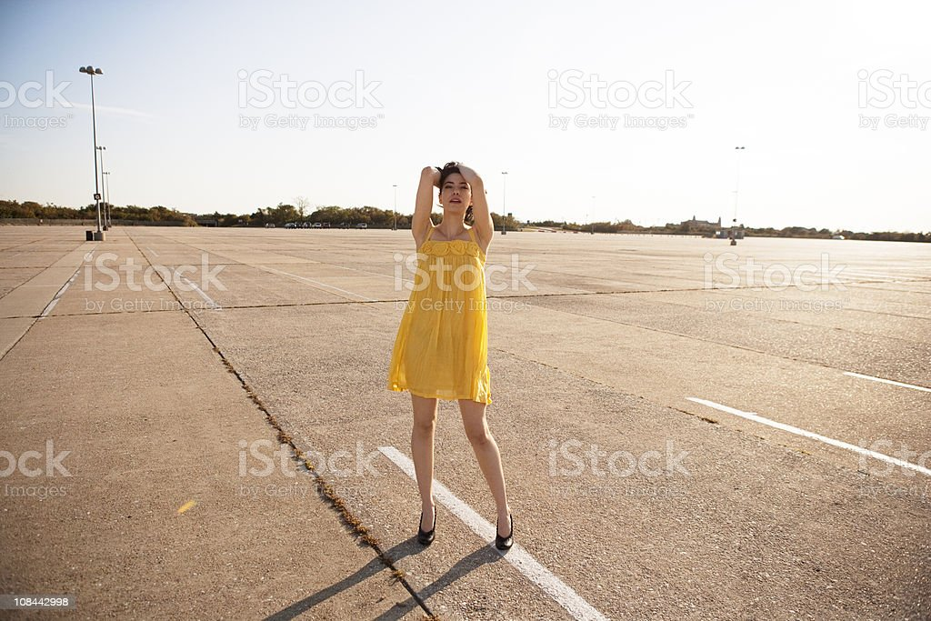 Girl in parking lot stock photo