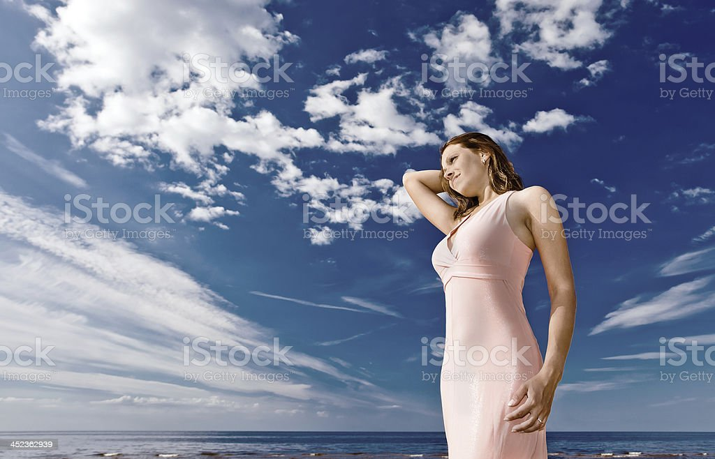 girl in pink dress on seacoast royalty-free stock photo
