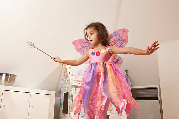 girl in pink dress with fairy wings - fairy wand stock photos and pictures