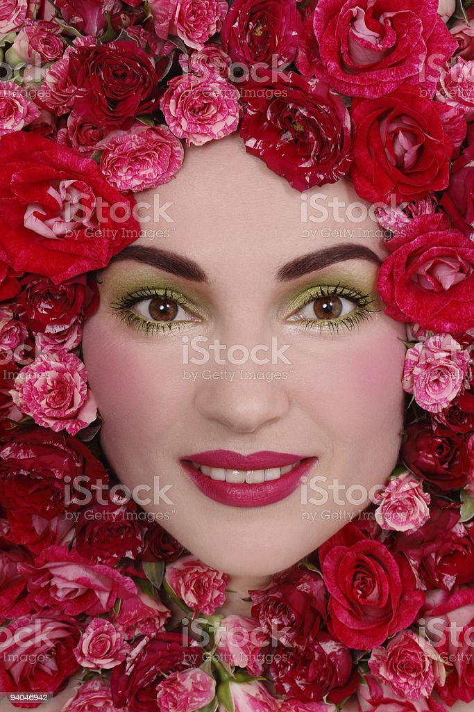 Girl in pink roses royalty-free stock photo