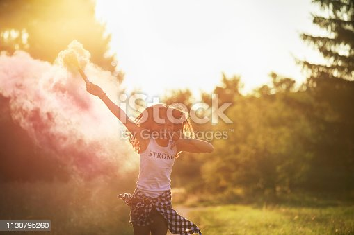 Angry girl in pink smoke.