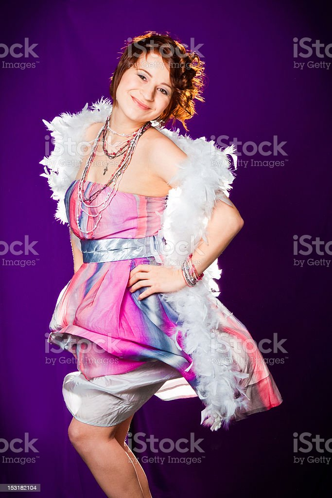 girl in pink with white boa stock photo