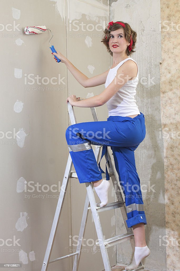 girl in pin-up standing on  ladder with molar Rollick stock photo