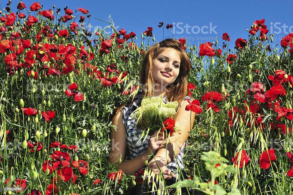 girl in poppy field royalty-free stock photo