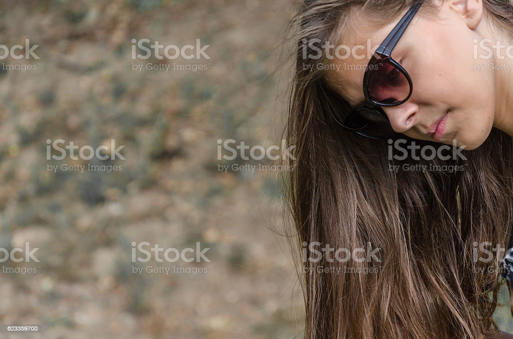girl in puberty falling hair in autumn stock photo