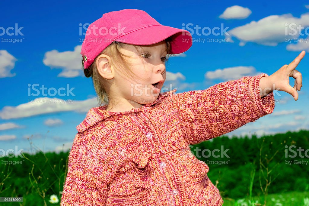 Girl in red cap royalty-free stock photo