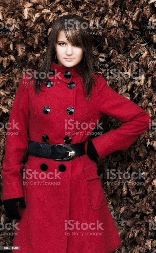 girl in red coat stock photo