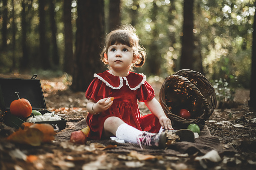 Happy Daughter Having A Picnic in The Forest On Halloween