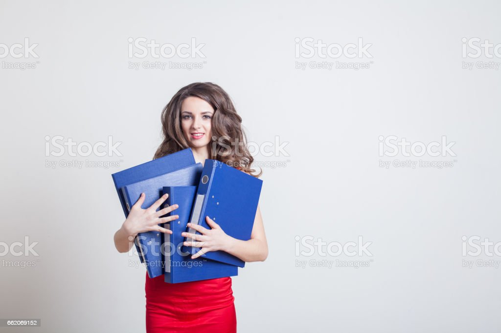 girl in red dress Manager with folders royalty-free stock photo