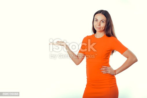 Girl in red dress on a white background indicates hand.