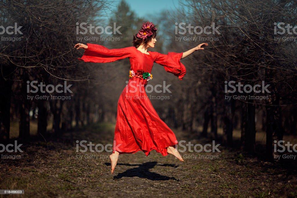 Girl in red dress soars. stock photo