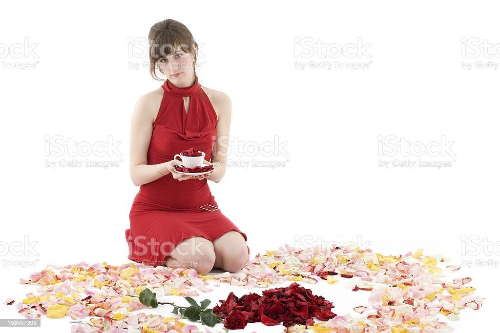 girl in red dress surrounded by petals royalty-free stock photo