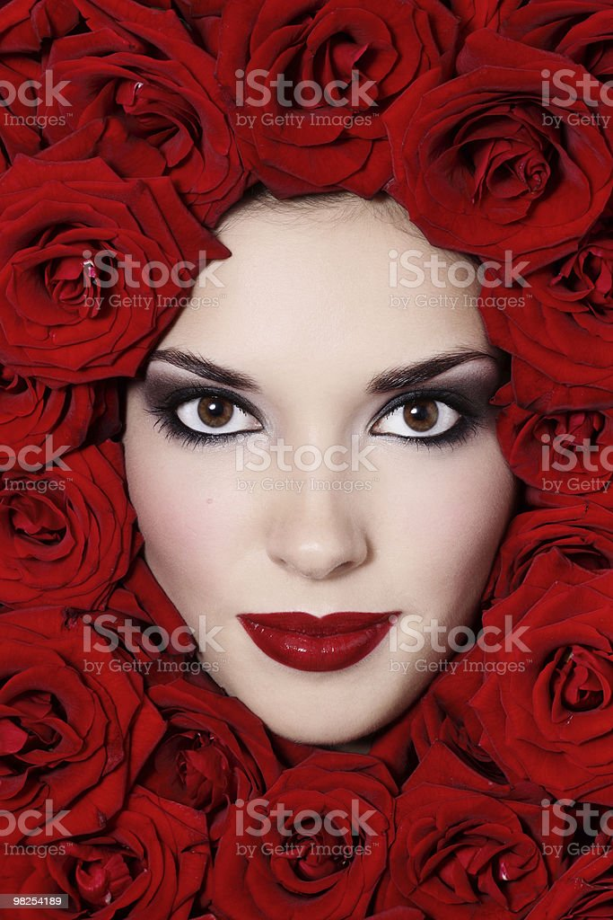 Girl in red roses royalty-free stock photo