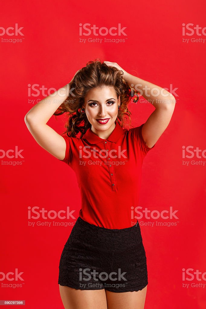 Girl in red shirt and shorts royaltyfri bildbanksbilder