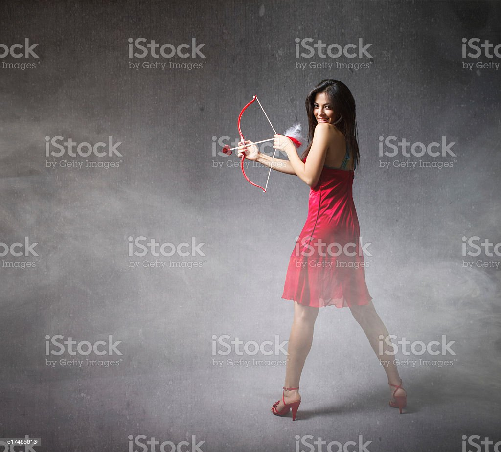 girl in red with arrow and bow stock photo