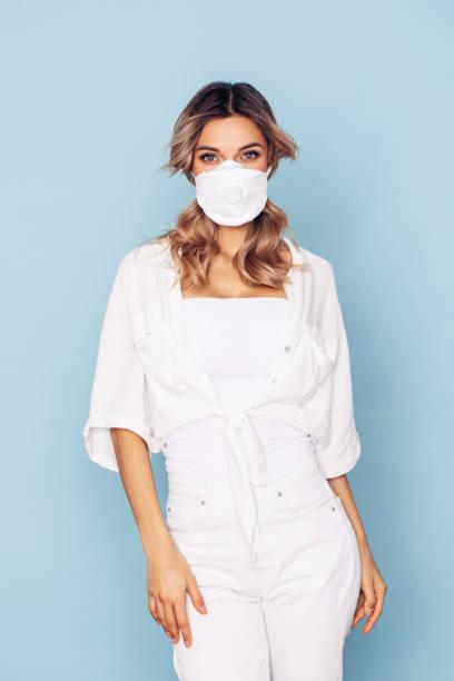 Girl in respiratory mask stock photo