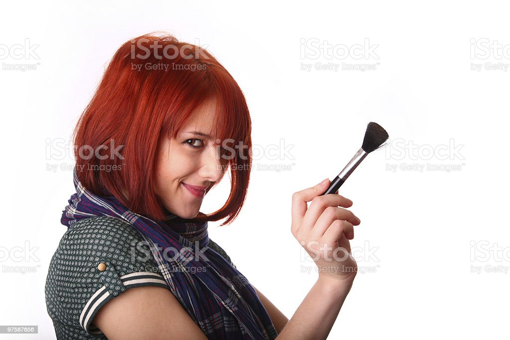 Girl in scarf and make-up brush royalty-free stock photo