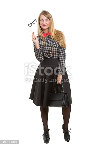 509923232istockphoto girl in skirt with bag. the bow tie. Isolated on 497965680