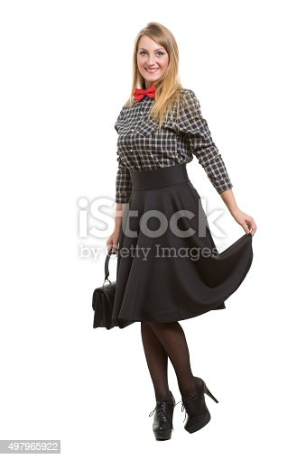 509923232istockphoto girl in skirt with bag. the bow tie. Isolated on 497965922