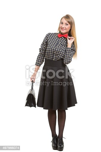 509923232istockphoto girl in skirt with bag. the bow tie. Isolated on 497966074