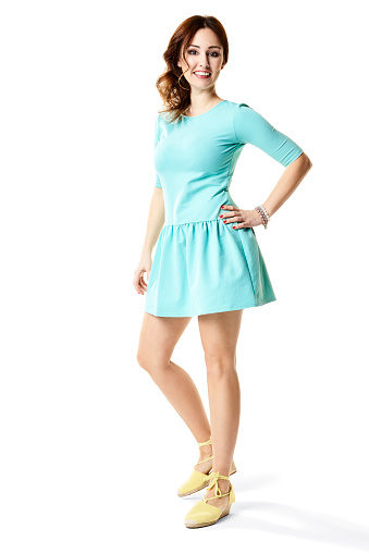 Brightly shot of young woman in sports turquoise dress.