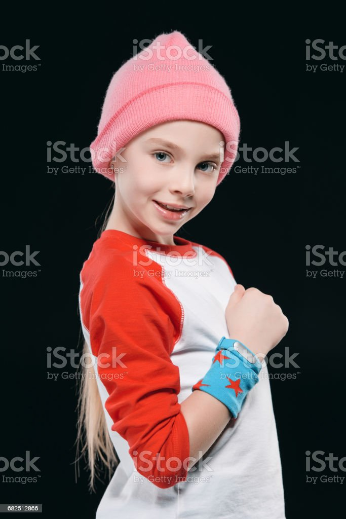 girl in sportswear with sweatband and fitness tracker isolated on black. equipment sport  concept Стоковые фото Стоковая фотография