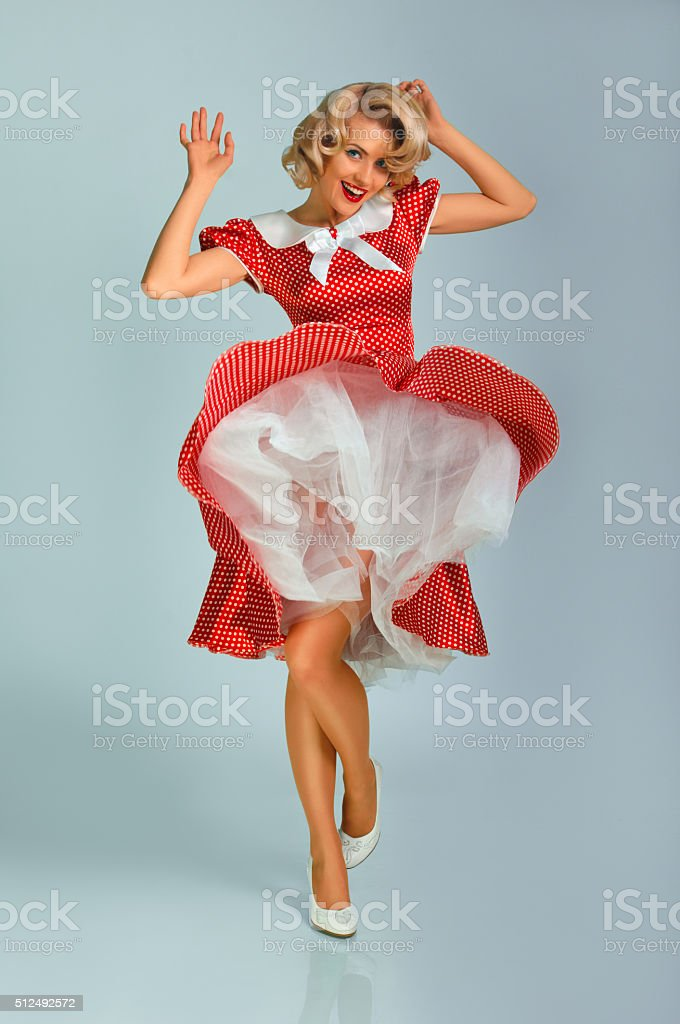 girl in spotted dress stock photo