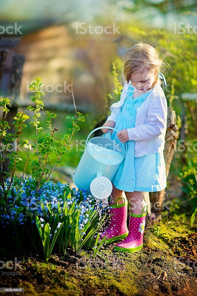 Girl in spring garden stock photo