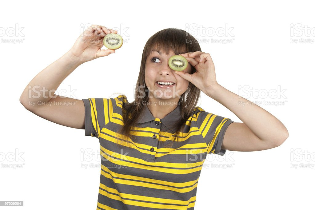 Girl in striped cloth and kiwi instead of eye royalty-free stock photo