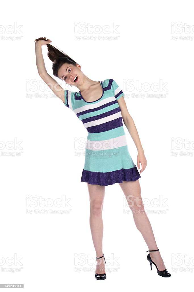 Girl in stripy blue dress pull her hairs. royalty-free stock photo
