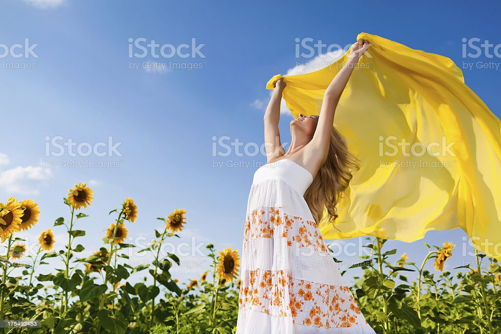 Girl in sunflowers royalty-free stock photo