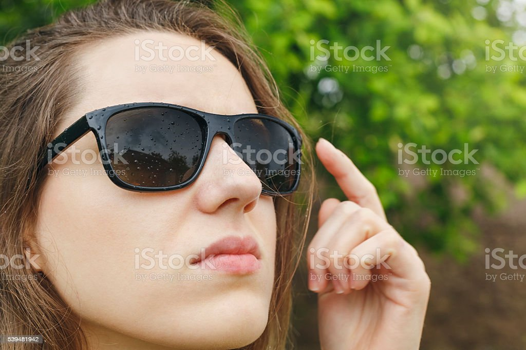 acad351b5 Girl In Sunglasses Rain Looking At The Sky Stock Photo & More ...