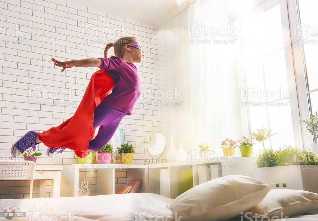 girl in Superhero's costume stock photo