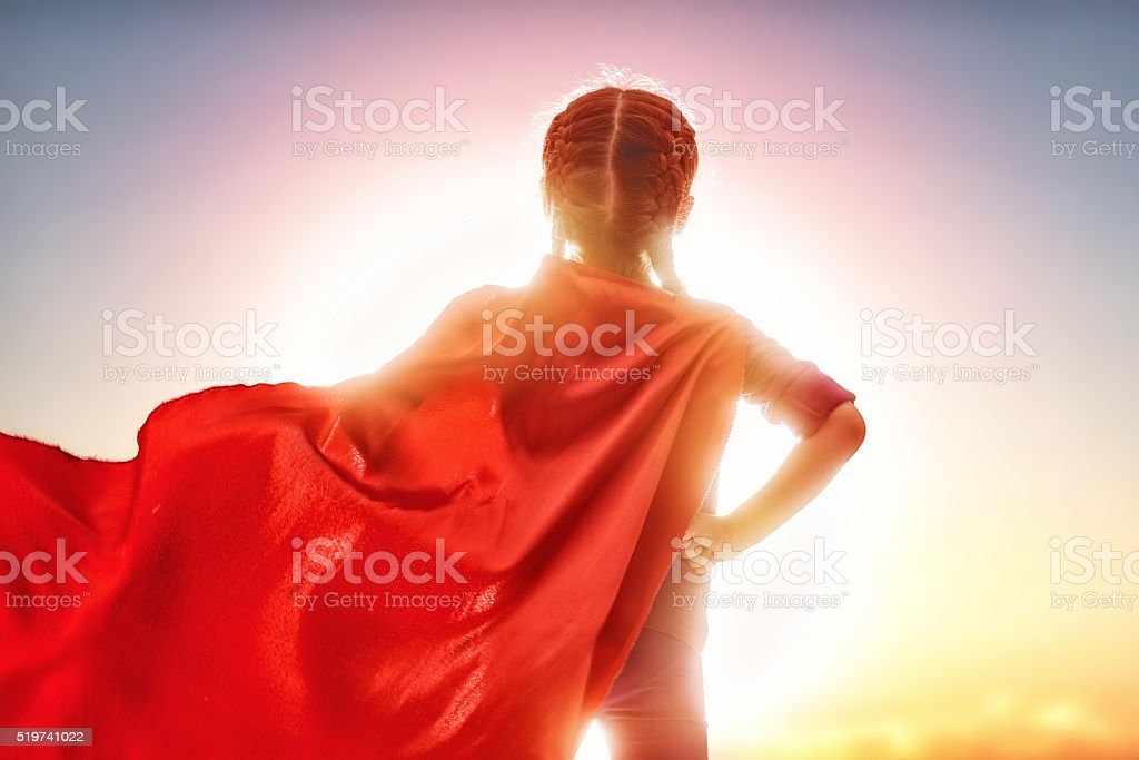 girl in Superhero's costume stock photo