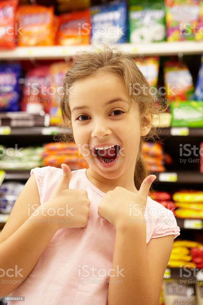 Girl in supermarket confectionery aisle royalty-free stock photo