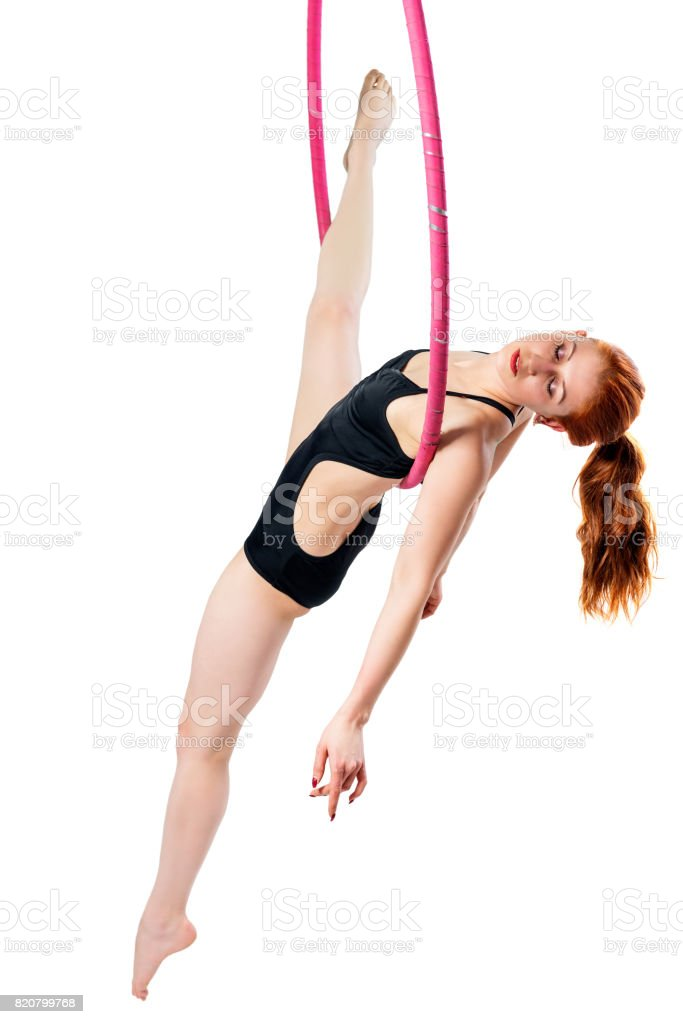 girl in the air ring with a good stretching on a white background stock photo