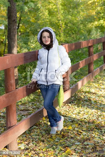 istock girl in the autumn park 509792500