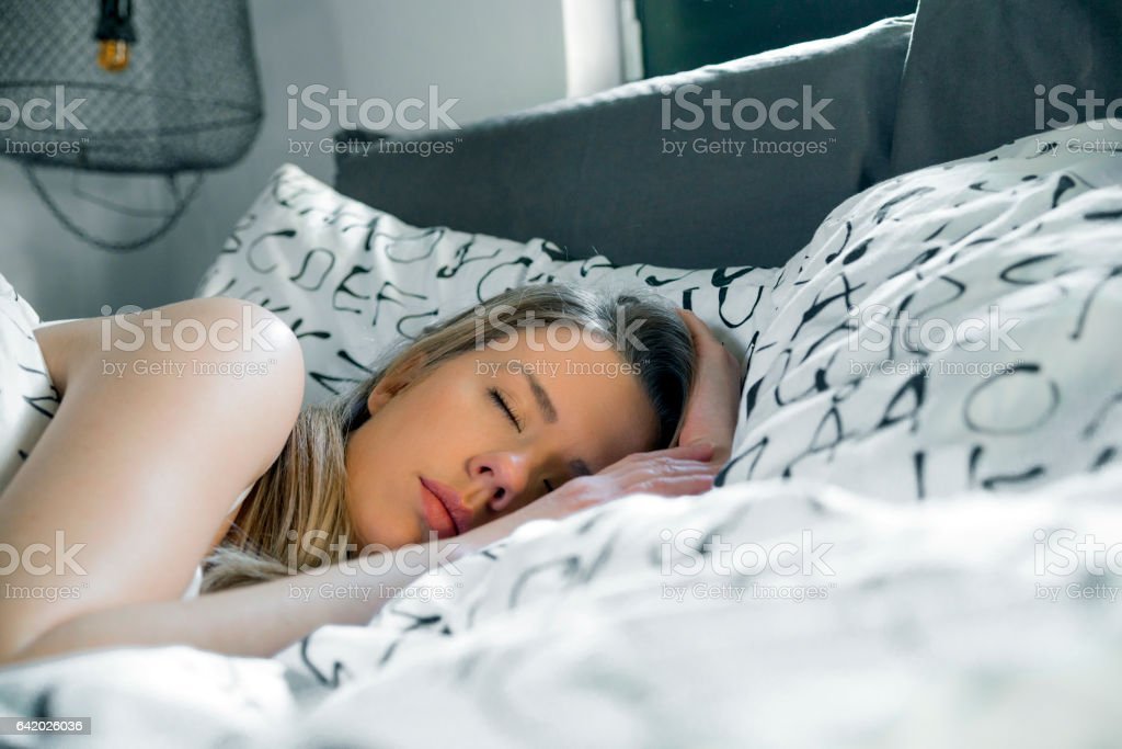 girl in the bed in the morning stock photo