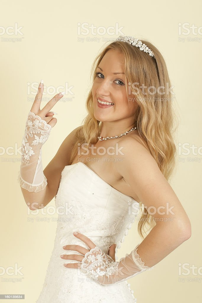 girl in the bride's dress with arm raised royalty-free stock photo