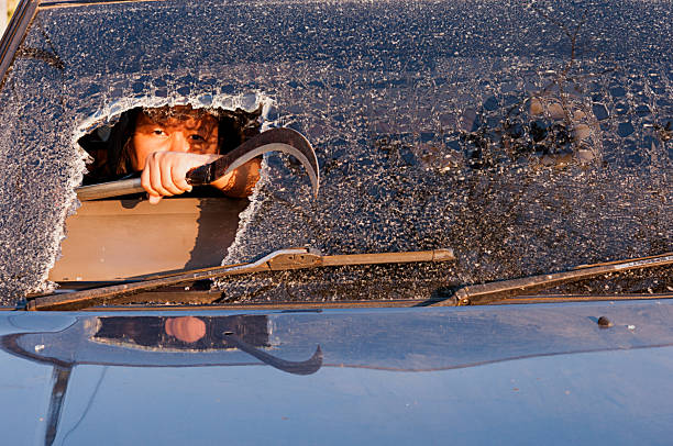 girl in the car at  windshield face crack. call for help - impaired driving stock photos and pictures