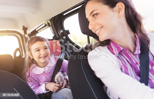 istock Girl in the car with her mother 901846468