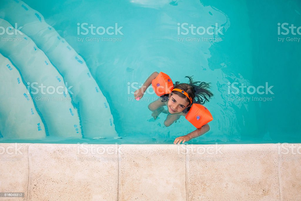 Girl in the Pool stock photo