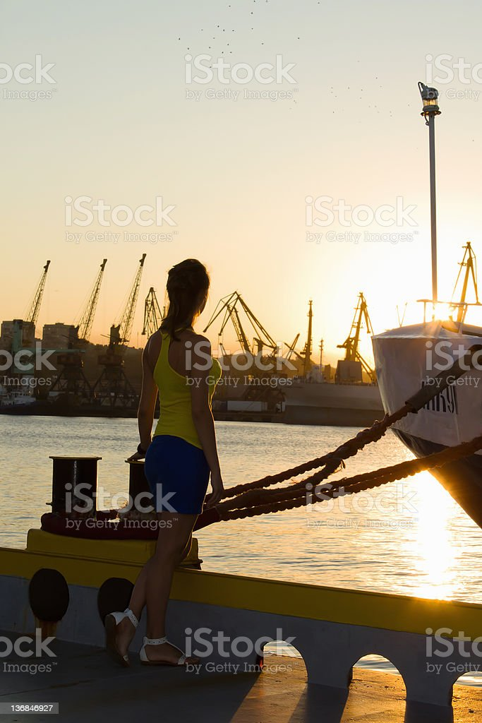 girl in the port at sunset royalty-free stock photo