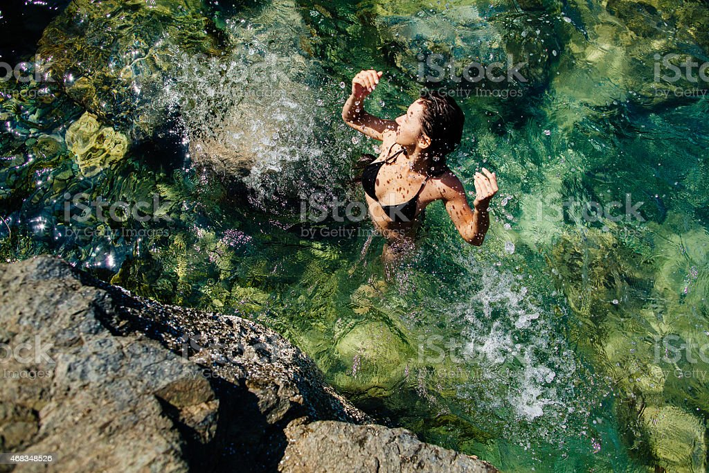 girl in the sea lagoon aerial top view royalty-free stock photo
